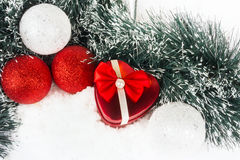 Red heart box in snow. On white Royalty Free Stock Photos