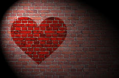Red heart on brick wall Stock Photography