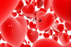 Red heart broken by arrow Stock Photo
