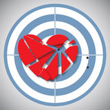 Red heart broken into pieces on the blue target Royalty Free Stock Photos