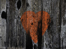 Red heart on brown wooden background Stock Image