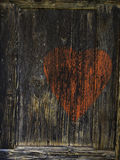 Red heart on brown wooden background. Red heart on old brown wooden background. Old love Royalty Free Stock Image