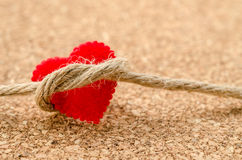 Red heart with a bundle rope Stock Image