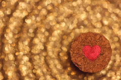 Red heart on the bung with golden bokeh background Stock Photo