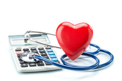 Red heart and calculator with stethoscope on white background Stock Photo