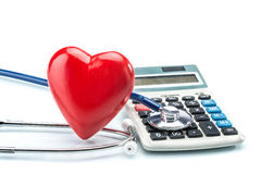 Red heart and calculator with stethoscope on white background Stock Images