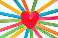 Red heart candle. With colorful wooden stripes on the white background Stock Photos