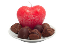 Red heart-candle and chocolate sweets Stock Photo