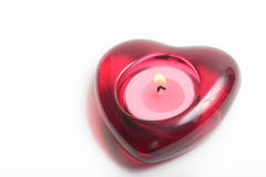 Red heart candle with flame stock image