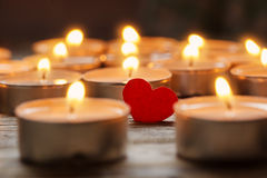 Red heart with candles on lights background, love concept Stock Photography