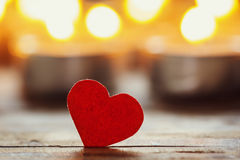 Red heart with candles on lights background, love concept, Stock Photos