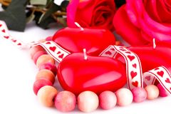 Red heart candles, necklace and roses Royalty Free Stock Image