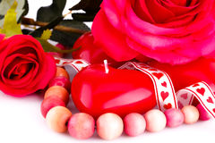 Red heart candles, necklace and roses Royalty Free Stock Photos