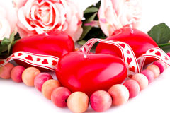 Red heart candles, necklace and roses Stock Photo