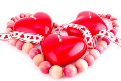 Red heart candles and necklace Stock Photos