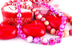Red heart candles, necklaces and gift boxes Stock Photography