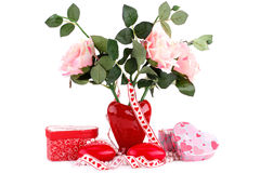Red heart candles, roses, necklace and gift boxes. Red heart candles, roses in vase, necklace and gift boxes on white background Stock Images