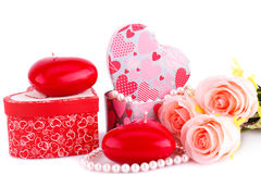 Red heart candles, roses, necklace and gift boxes. On white background Stock Photos