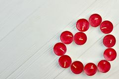 Red heart from candles, top view. stock image