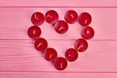 Red heart from candles, top view. royalty free stock images