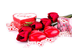 Red heart candles, tulips, necklaces and gift boxes Royalty Free Stock Images