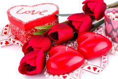Red heart candles, tulips, necklaces and gift boxes Royalty Free Stock Photo