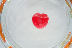 Red heart candy on the glass royalty free stock photography