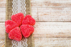 Red heart candy and lace on wooden board royalty free stock photography