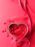 Red heart candy with ribbons vertical Royalty Free Stock Image