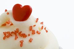 Red Heart Candy on top of cupcake Stock Image