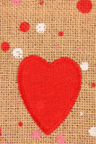 Red heart on canvas Stock Photos