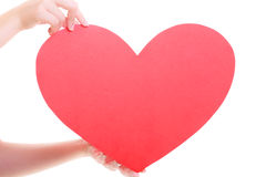 Red heart card. Love symbol. Woman hold Valentine day symbol. Stock Image