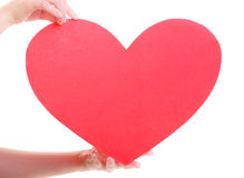 Red heart card. Love symbol. Woman hold Valentine day symbol. Stock Photo