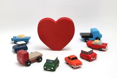 Red heart and cars on white background. Shape of red heart  and car on white background. Safe driving concept Stock Photo