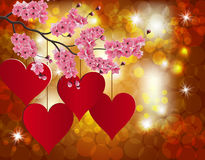 Red heart on a celebratory background. Flowering branch of cherry.  Stock Images