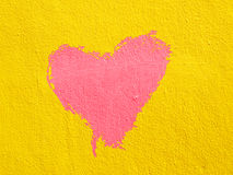 Red heart on cement wall Royalty Free Stock Images