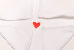 Red Heart in the center. Red hearts on a white cloth to the center Stock Photos