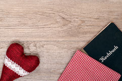 Red heart with checkered cloth and book Royalty Free Stock Photo