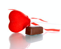 Red heart and chocolate candy Stock Images