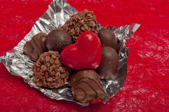 red heart and chocolates on red sisal Royalty Free Stock Photos