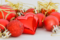 Red heart and Christmas ball ornaments Stock Images