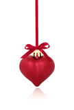 Red Heart Christmas Bauble. Red heart shaped christmas bauble with ribbon and bow, isolated over white background with reflection Stock Images
