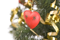 Red heart on Christmas tree Royalty Free Stock Photo