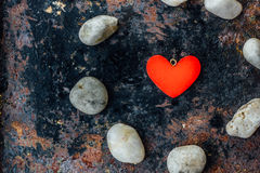 Red heart in circle of rocks Royalty Free Stock Photography