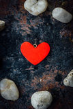 Red heart in circle of rocks Stock Photo