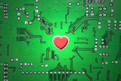 Red heart and circuit board Stock Photos