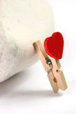 Red heart and clothes pin Stock Images