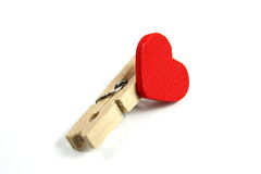 Red heart and clothes pin Royalty Free Stock Images