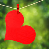 Red Heart with Clothespin Hanging on Clothesline over Green. Background. Valentines Day Stock Images