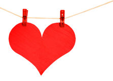 Red Heart with Clothespins hanging on clothesline isolated Royalty Free Stock Photography